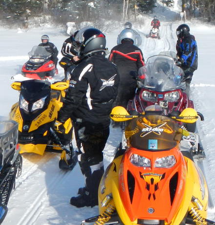Riders come to the end of the run at the Sioux Lookout Snowarama