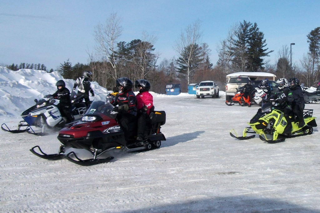 Riders drive away from the starting point