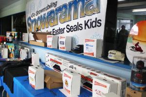 A Snowarama banner hangs over a prize display