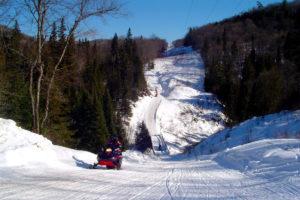 A lone rider on a long winding trail fullof hills