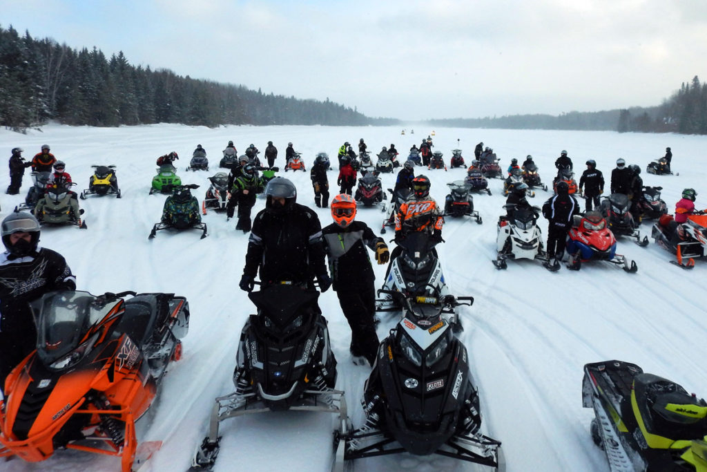 A pack of snowmobilers on the ice