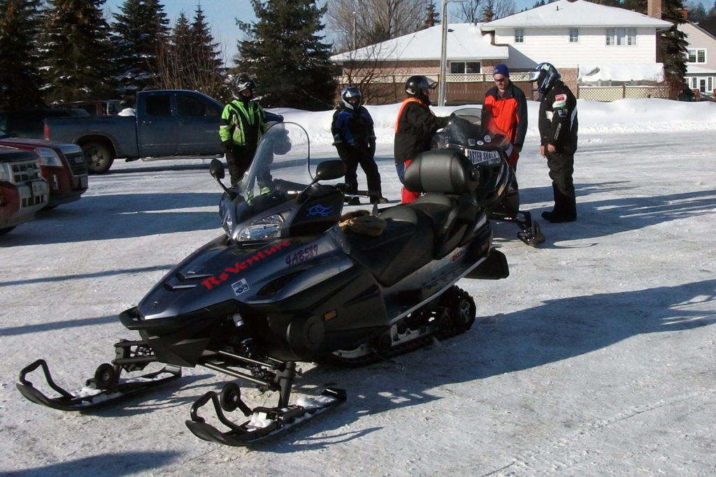 A close up of a black snowmobile