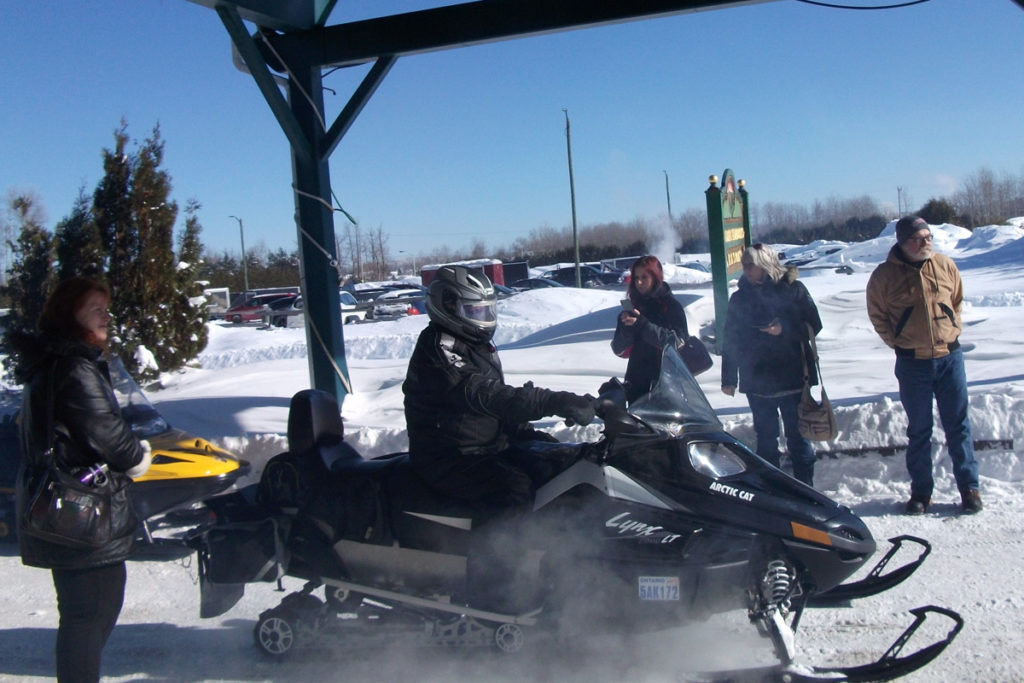 A rider on a black snowmobile