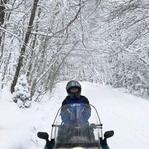 A lone rider on a snowy trail